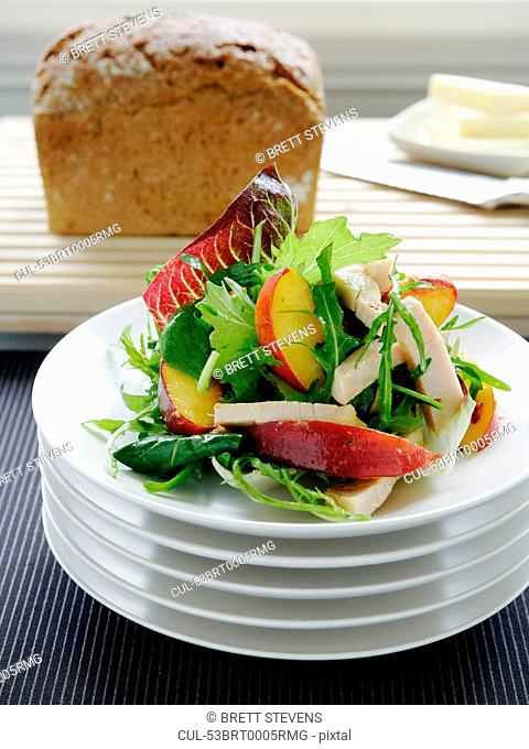 Plate of turkey and peach salad