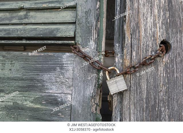 New Orleans, Louisiana - The lock on a vacant house