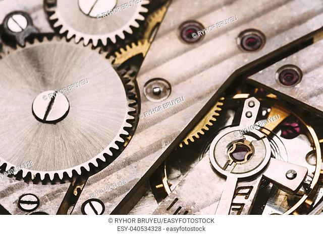 Old Retro Clockwork Background. Clock Watch Mechanism With Gray And Golden Gears. Vintage Mechanism With Movement Mechanics