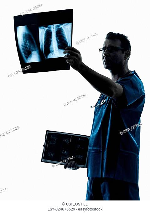doctor surgeon radiologist examining lung torso x-ray image sil