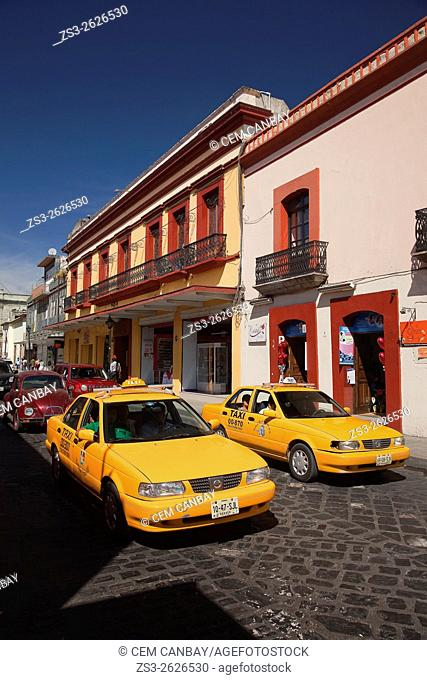 Taxis in front of colonial buildings at the historic center, Oaxaca, Oaxaca State Mexico, Central America