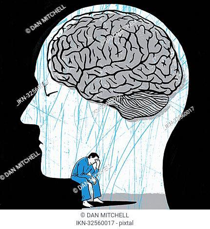 Depressed man inside head with brain