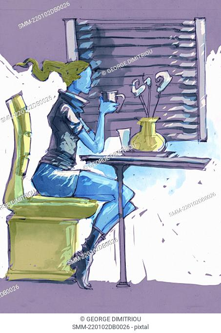 Woman sitting at a table with a cup of coffee