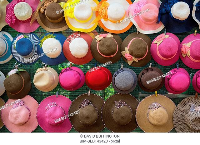 Close up of colorful hats hanging on wall