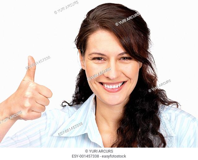 Portrait of a beautiful young woman gesturing thumbs up sign against white background