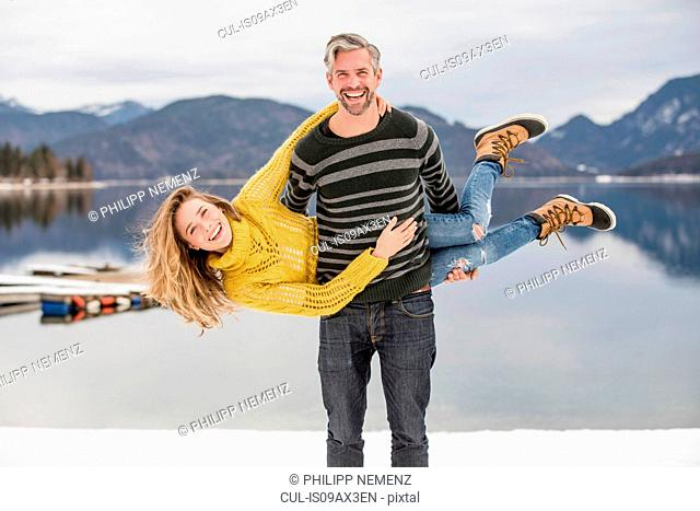 Portrait of man carrying woman on side, German Alps, Germany