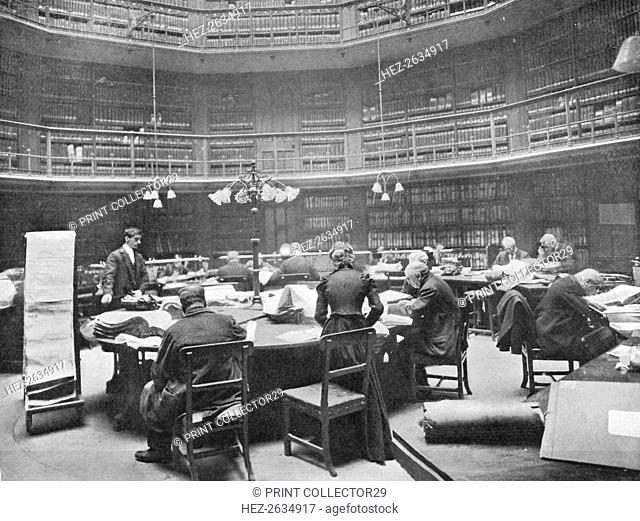 Visitors searching through volumes at the Public Record Office, Chancery Lane, London, 1903. Artist: Unknown