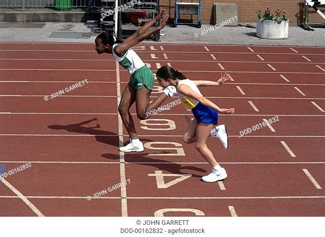 Two Girls Finishing a Race, at Finishing Line on Track