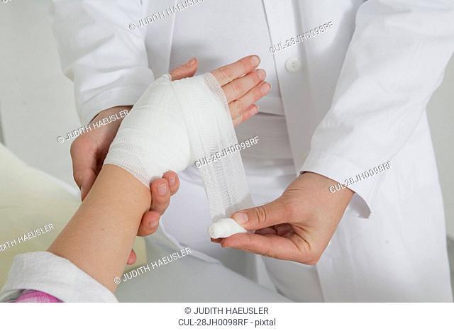 Close up nurse applying a dressing