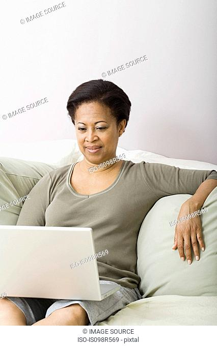 Mature woman using laptop