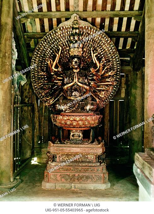 A statue of the Buddha of a Thousand Arms and Thousand Eyes, seated on a lotus