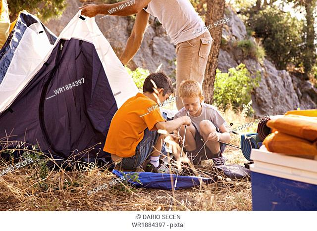 Croatia, Dalmatia, Family pitching the tent on camp site