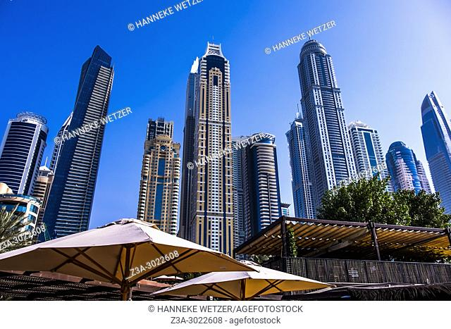 Barasti Beach Club in front of supertall skyscrapers at Dubai Marina, Dubai, UAE