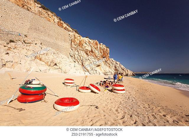 People sunbathing at Kaputas beach, between Kalkan and Kas, Antalya Region, Turkish Riviera, Turkey, Europe