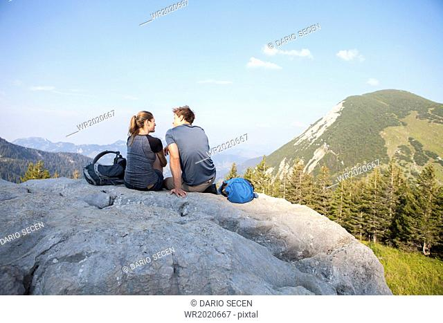 Young couple resting on mountain peak