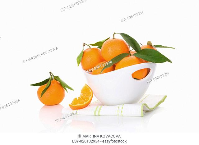 Fresh ripe mandarines in white bowl isolated on white background. Healthy fruit eating
