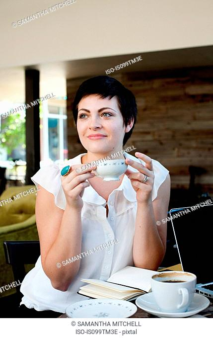 Young woman in cafe with tea