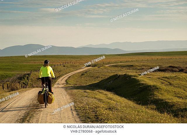 Bike traveller in Alcañizo, Toledo province, Castile LaMancha, Spain