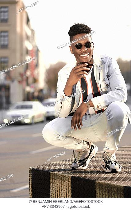 young African man in city, in Munich, Germany