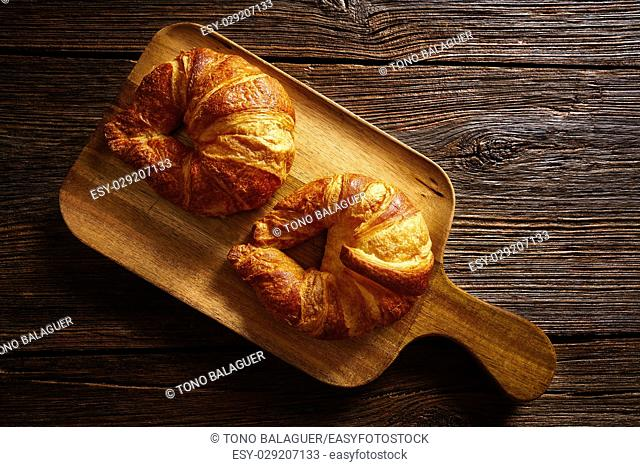 Croissants in a wooden board table