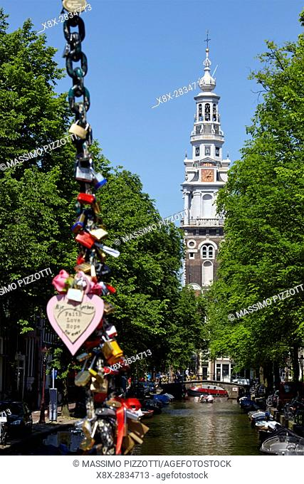 Padlock on the bridge over Groenburgwal canal with Zuiderkerk bell tower, Amsterdam, Netherlands
