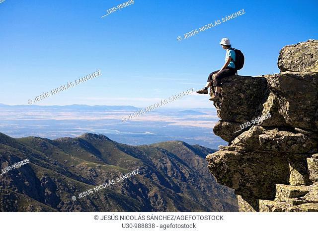 Woman practice mountaineering in the mountains of the Sierra de Gredos National Park  Valley of the Garganta Lóbrega  Navacepeda de Tormes  Ávila  Castilla y...