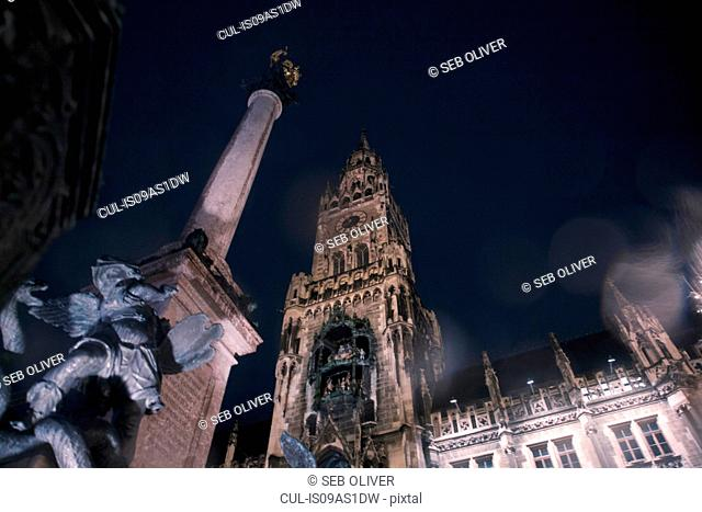 The New Rathaus (Town Hall) and statue at night, Munich, Germany