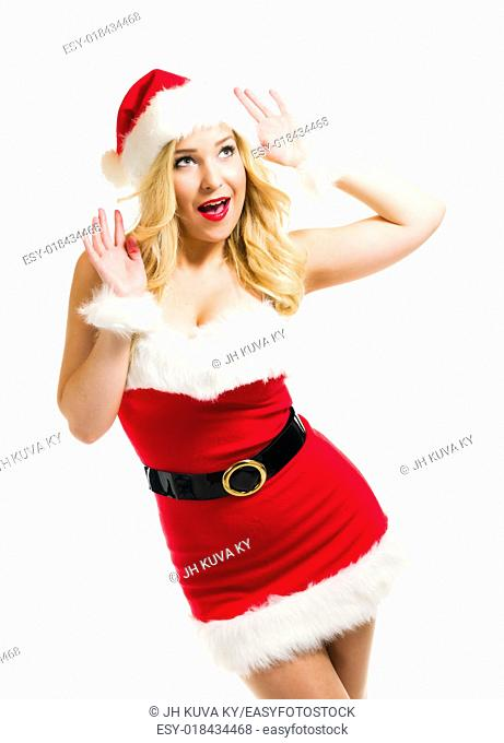 Attractive girl wearing on Santa Claus costume, waist up composition and white background