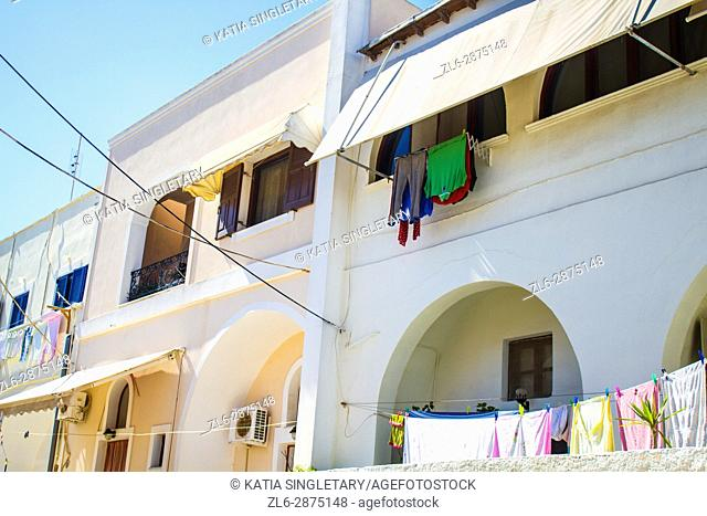 A lot of Laundry hang at many windows of houses in Europe, Greece, on the island of Santorini