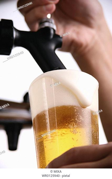 A man pouring beer into glass