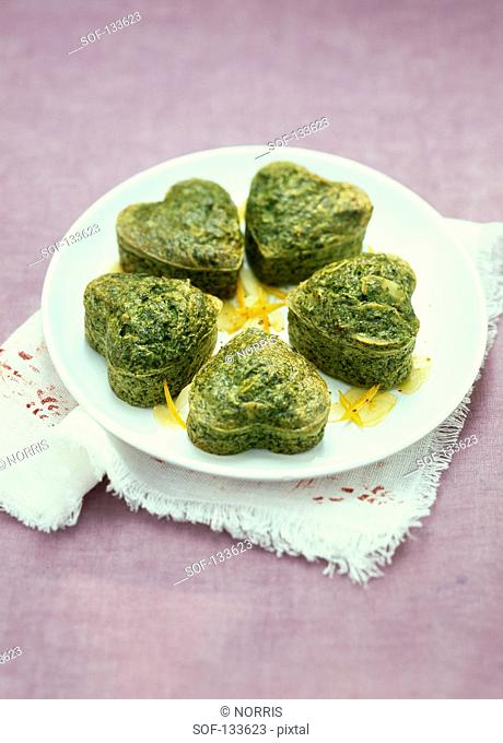 Heart-shaped spinach,orange zests and almond Flans