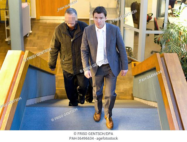 Defendant Fendi O. (L) and his lawyer Thorsten Giesecke (R) appear at the Regional Court in Detmold, Germany, 28 January 2013