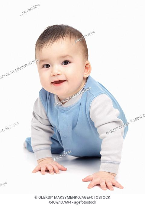 Portrait of a smiling happy seven month old baby boy crawling isolated on white background