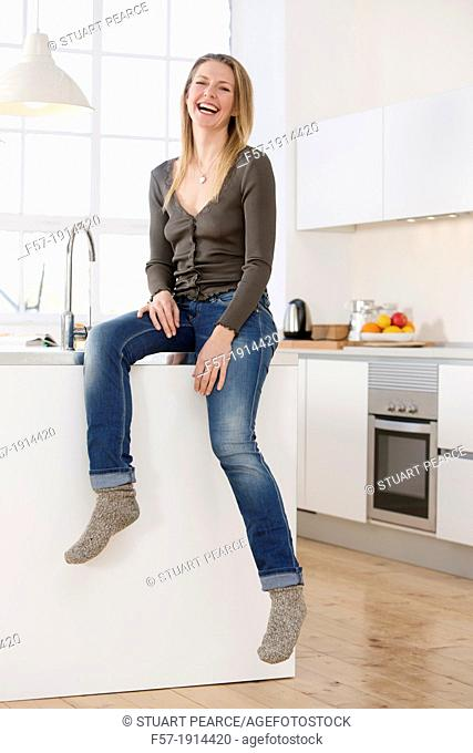 Attractive young woman in her kitchen
