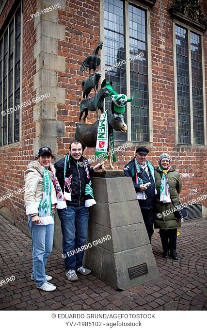 Fans of the local football team of Bremen at the statue of the Bremen Town Musicians. Bremen, Germany, Europe