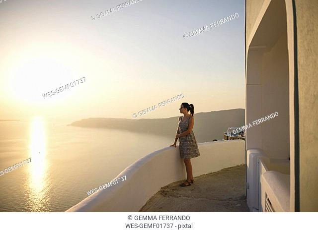 Greece, Santorini, Fira, woman enjoying the sunset