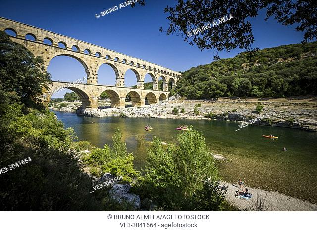 Kayaking in roman aqueduct Pont du Gard (department of Gard, region of Occitanie, France)
