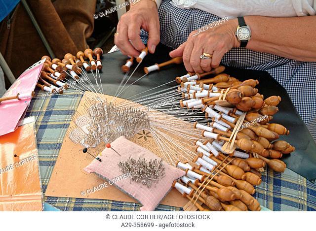 Bobbin lace maker. Trammelant festival, Belle Epoque style. Coq-sur-Mer. Belgium