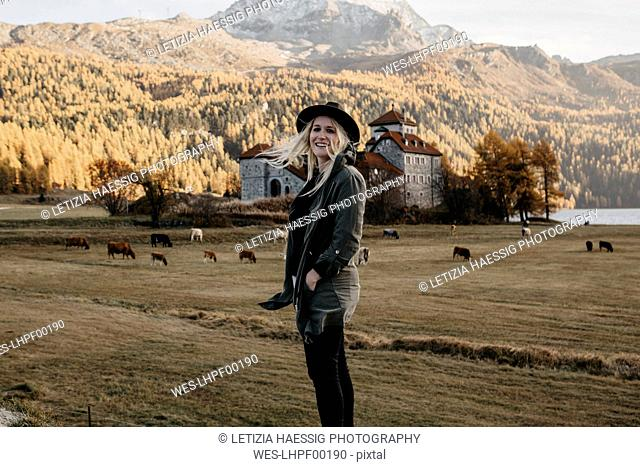 Young woman travelling through Switerland, looking at nature