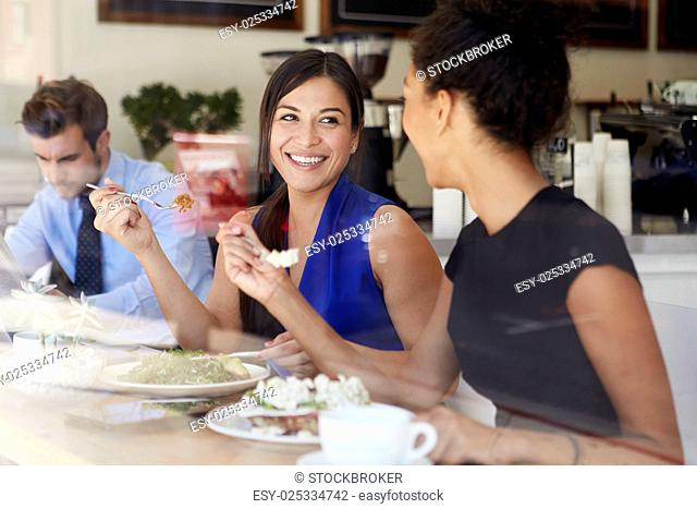 Two Businesswomen Meeting For Lunch In Coffee Shop
