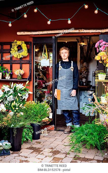 Caucasian florist standing outside shop