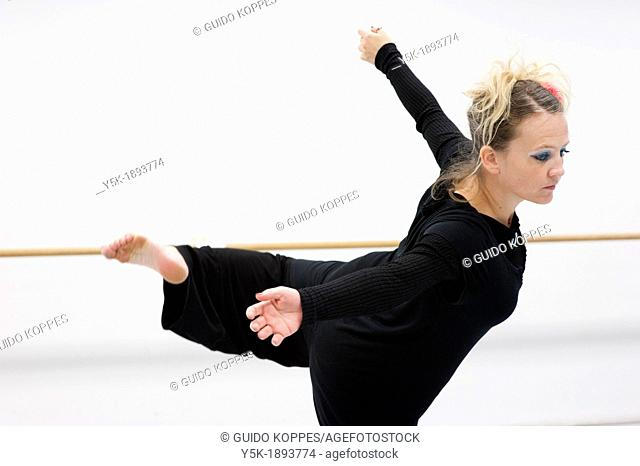 Tilburg, Netherlands. A professional dancer and choreographer of modern dance during a rehearsal of improvised, modern dance