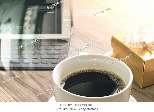 Coffee cup and Digital table dock smart keyboard,gold gift box and round wood tray,color pencil on wooden table,filter effect,icons screen