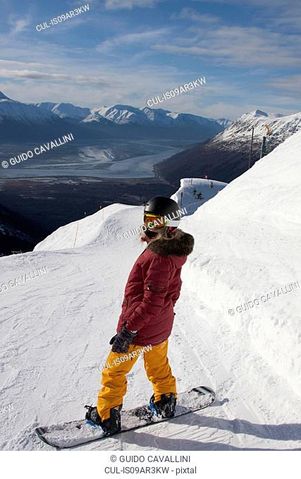 Young woman snowboarding, Girdwood, Anchorage, Alaska