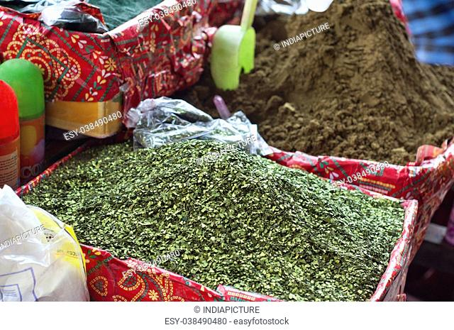Henna leaves and powder for sale at market