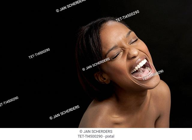 Young woman bursting with laugh