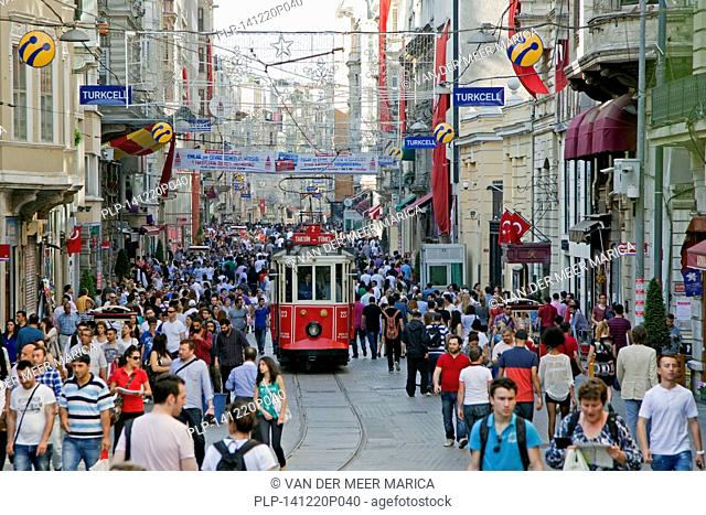 Historic tram in Istiklal Avenue, busy shopping street near Taksim square in the city Istanbul, Turkey
