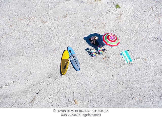 Aerial of beachgoers enjoying the sun and sand on coastline of South Carolina