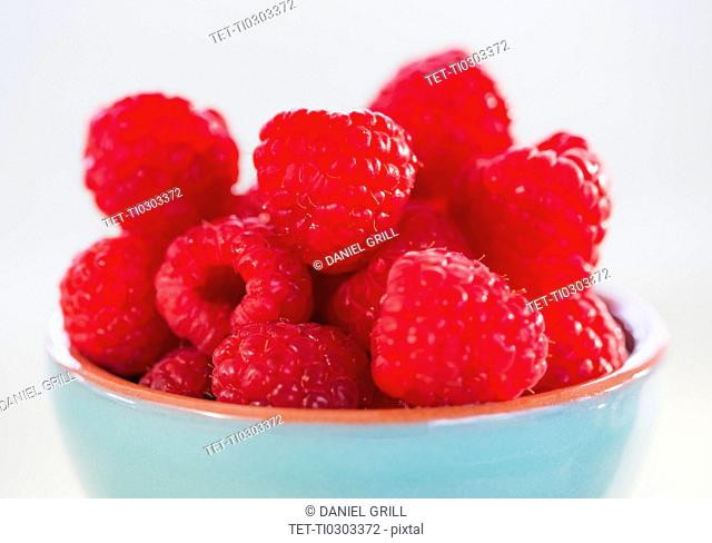 Bowl filled with fresh raspberries
