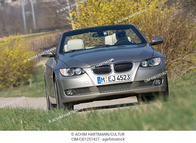 BMW 335i Convertible, model year 2007-, silver, driving, diagonal from the front, frontal view, country road, open top